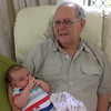Great granddad proudly holding Maddox the new generation
