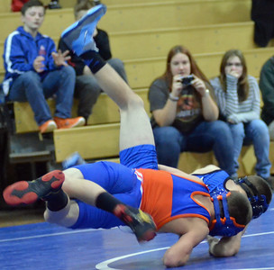 KYLE MENNIG - ONEIDA DAILY DISPATCH Camden's Devin Coleman and Oneida's Dustin Coleman wrestle at 99 during a dual in Oneida on Wednesday, Dec. 7, 2016.