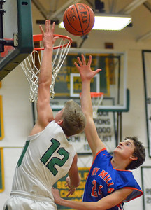 KYLE MENNIG - ONEIDA DAILY DISPATCH Hamilton's Trevor Dow (12) goes up for a layup as New York Mills' Alex Matrassi (24) defends during their game in Hamilton on Thursday, Dec. 1, 2016.