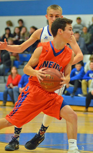 KYLE MENNIG - ONEIDA DAILY DISPATCH Oneida's Tanner Williams (10) drives to the basket as Camden's Austin Roser (3) defends during their game in Camden on Tuesday, Dec. 6, 2016.