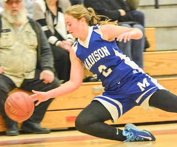 KYLE MENNIG - ONEIDA DAILY DISPATCH Madison's Kayla Usborne (2) dives to try and save the ball from going out of bounds against Stockbridge Valley during their game in Munnsville on Saturday, Dec. 17, 2016.