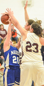 KYLE MENNIG - ONEIDA DAILY DISPATCH Madison's Baileigh Strong (20) has her shot blocked by Stockbridge Valley's Olivia Marshall (21) as Adrianna Cox (23) also defends during their game in Munnsville on Saturday, Dec. 17, 2016.