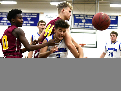 12/22/2016 Mike Orazzi | Staff Bristol Eastern High School's Tyler Mason (3) and New Britain's Jemani Eaton (0) and Daniel Kownacki (44) in Bristol Thursday night.