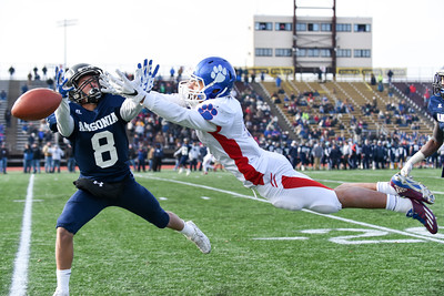121016 Wesley Bunnell | Staff  Ansonia defeated Rocky Hill 28-21 in the Class S Football Championship Saturday at Veteran's Stadium in New Britain.  Ansonia's Justin Lopez (8) breaks up a reception by Grant Nieves (5).