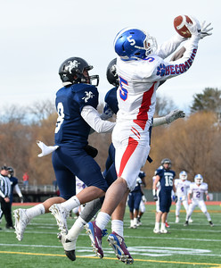 121016 Wesley Bunnell | Staff  Ansonia defeated Rocky Hill 28-21 in the Class S Football Championship Saturday at Veteran's Stadium in New Britain.  Rocky HIll's Grant Nieves (5) with a touchdown catch late in the game.