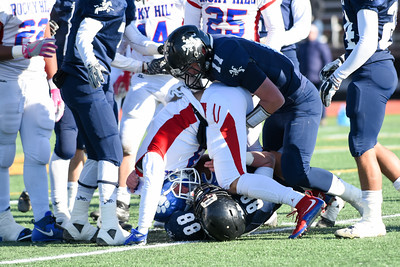 121016 Wesley Bunnell | Staff  Ansonia defeated Rocky Hill 28-21 in the Class S Football Championship Saturday at Veteran's Stadium in New Britain. Ansonia Cody Teodosio (11) attempts to strip the ball from the Rocky Hill ball carrier.