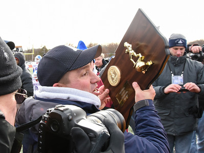 121016 Wesley Bunnell | Staff  Ansonia defeated Rocky Hill 28-21 in the Class S Football Championship Saturday at Veteran's Stadium in New Britain.  Ansonia coach Thomas Brockett hoists the Class S Championship Plaque.
