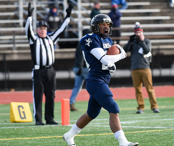 121016 Wesley Bunnell | Staff  Ansonia defeated Rocky Hill 28-21 in the Class S Football Championship Saturday at Veteran's Stadium in New Britain.  Jake Butler (24) catches a touchdown pass for Ansonia.