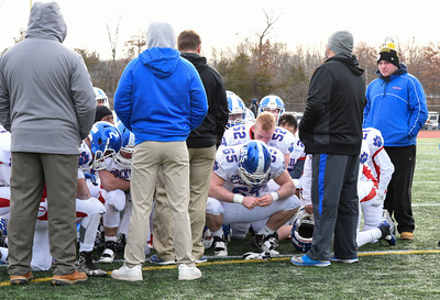 121016 Wesley Bunnell | Staff  Ansonia defeated Rocky Hill 28-21 in the Class S Football Championship Saturday at Veteran's Stadium in New Britain.  Rocky Hill players take a knee after their loss to Ansonia while being addressed by the coaches.