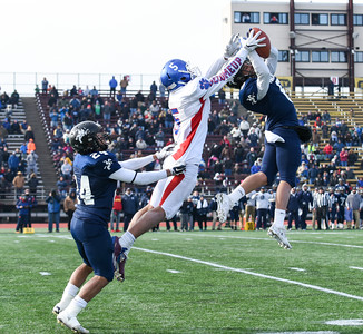 121016 Wesley Bunnell | Staff  Ansonia defeated Rocky Hill 28-21 in the Class S Football Championship Saturday at Veteran's Stadium in New Britain.  Rocky HIll's Grant Nieves (5) goes up for a pass.