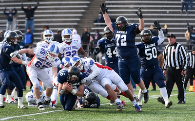 121016 Wesley Bunnell | Staff  Ansonia defeated Rocky Hill 28-21 in the Class S Football Championship Saturday at Veteran's Stadium in New Britain.  Ansonia's Bryson Cafaro (16) runs the ball in for a touchdown as teammates Joseph DeCiucis (72) and Kevin Rascoe (50) signal touchdown.