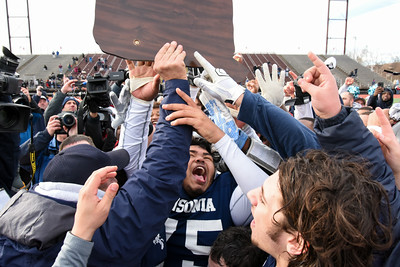 121016 Wesley Bunnell | Staff  Ansonia defeated Rocky Hill 28-21 in the Class S Football Championship Saturday at Veteran's Stadium in New Britain. Chazz Sanders (75) with the championship plaque.