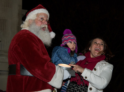 120116  Wesley Bunnell | Staff  Santa Claus visited Central Park in New Britain on Thursday evening for the annual Christmas Tree lighting. Mayor Erin Stewart holds four year old Emma Ciccarillo as she helps to light the city Christmas tree.
