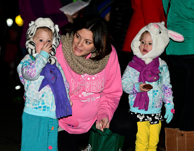 12/1/2016 Mike Orazzi | Staff Heather Castonguay and her twin daughters Lucy and Layla,3, during the annual tree lighting at the Plainville Fire Company Thursday evening.