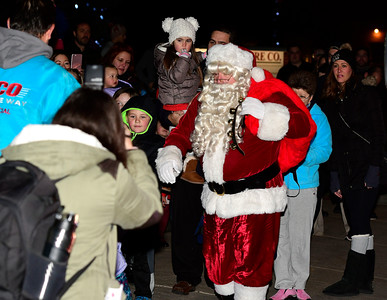 12/1/2016 Mike Orazzi | Staff Santa arrives during the annual tree lighting at the Plainville Fire Company Thursday evening.