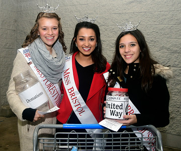 12/1/2016 Mike Orazzi | Staff Miss Bristol 2017 Gina Salvatore (center) with Miss Forestville's Outstanding Teen Cassandra Lechner (left) and Miss Bristol's Outstanding Teen Victoria Kilbourne (right) during a toy drive outside the Bristol Walmart Thursday night.