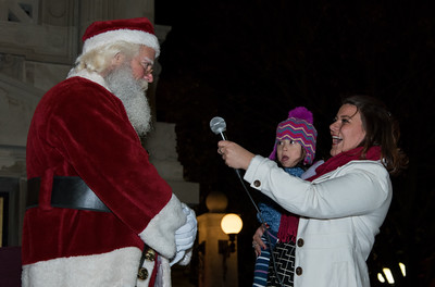 120116  Wesley Bunnell | Staff  Santa Claus visited Central Park in New Britain on Thursday evening for the annual Christmas Tree lighting. Mayor Erin Stewart holds four year old Emma Ciccarillo as she prepares to help light the city Christmas tree.