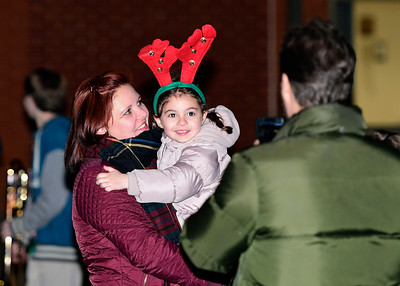 12/1/2016 Mike Orazzi | Staff Camila Manfred and her daughter Agnes,4, during the annual tree lighting at the Plainville Fire Company Thursday evening.