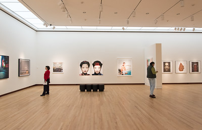 121216  Wesley Bunnell | Staff  Irene Pevac, left, faces opposite as her husband Lazar Pevac at the New Britain Museum of American Art with figures staring back in the middle by artist Dre Tal titled Porcelain Promises.