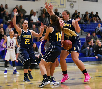121216  Wesley Bunnell | Staff  Plainville girls basketball was defeated by visiting Simsbury on Monday evening.  Lauren Tanner (12) is covered by three Simsbury defenders as she drives to the basket which resulted in a turnover.