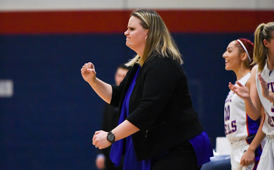121216  Wesley Bunnell | Staff  Plainville girls basketball was defeated by visiting Simsbury on Monday evening. Head coach Jessica Neuweiler pumps her fist after a Plainville score.