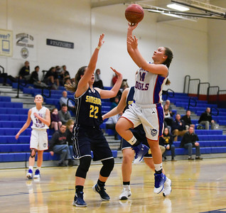 121216  Wesley Bunnell | Staff  Plainville girls basketball was defeated by visiting Simsbury on Monday evening. Taleah McCrorey (14) with a shot attempt.