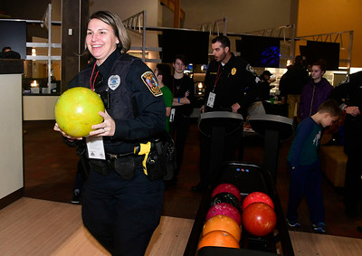 12/13/2016 Mike Orazzi | Staff Bristol Police Officer MJ Warner bowls during the Shop with a Cop event held at Crystal Bees in Southington Tuesday evening.