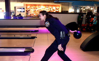 12/13/2016 Mike Orazzi | Staff Plainville Police Officer Evelyn Rodriguez bowls during the REACH Foundation's annual Shop With a Cop event held at Crystal Bees in Southington Tuesday evening.