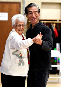 12/13/2016 Mike Orazzi | Staff Henry Ye and Theresa Auclaiwhile dancing at the Bristol Senior Center Tuesday afternoon.