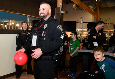 12/13/2016 Mike Orazzi | Staff Southington officer Matt Vose bowls during the Shop with a Cop event held at Crystal Bees in Southington Tuesday evening.