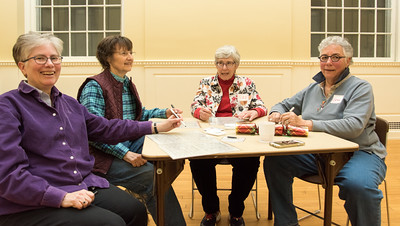 121316  Wesley Bunnell | Staff  A grassroots group of Lesbian, Gay, Bisexual and Transgender seniors held a meeting at the Simsbury Senior Center on Dec 13 involving food and games. The group holds events at different senior centers throughout the region about every month. Playing Bingo, from the left, are Joan Twiggs, Irene Scheibner, Susan Rapport and Geraldine Burke.