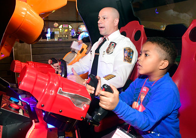 12/13/2016 Mike Orazzi | Staff Bristol Police Chief Brian Gould with Darius Callanes during the REACH Foundation's annual Shop With a Cop event held at Crystal Bees in Southington Tuesday evening.