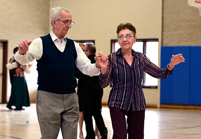 12/13/2016 Mike Orazzi | Staff Ed Swenton and Stephanie Dulka while dancing at the Bristol Senior Center Tuesday afternoon.