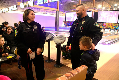 12/13/2016 Mike Orazzi | Staff Bristol Police Officer MJ Warner and Southington officer Matt Vose during the REACH Foundation's annual Shop With a Cop event held at Crystal Bees in Southington Tuesday evening.
