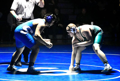 12/14/2016 Mike Orazzi | Staff Southington's Richard Zayas and Enfield's Andrew Diaz in the 220 at SHS.