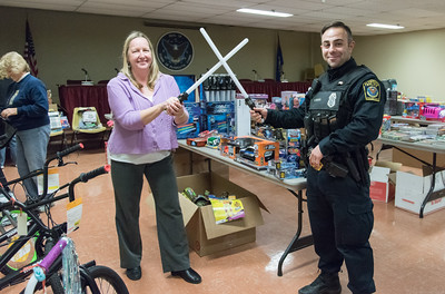 121416  Wesley Bunnell | Staff  The Town of Plymouth Human Services along with the Plymouth Police Department held their annual toy drive. Human Services Director, Heather Burns, left, shown with fellow toy drive coordinator Officer Cesar Beiros.