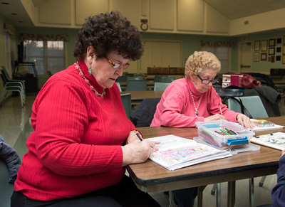 121416  Wesley Bunnell | Staff  Coloring Club is held every Wednesday from 3pm-5pm at the Plainville Senior Center.  Members of the club from left, Caroline Doirin and Alice Brousseau work on their holiday themed colorings.