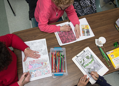 121416  Wesley Bunnell | Staff  Coloring Club is held every Wednesday from 3pm-5pm at the Plainville Senior Center.  Members of the club from left, Caroline Doirin, Alice Brousseau and Eileen Weber work on their holiday themed colorings.