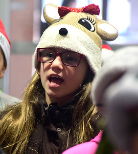 12/15/2016 Mike Orazzi | Staff South Side School's Community Club student Veronica Castro sings Christmas carols while delivering coffee and doughnuts to staff at the police and fire departments, and the post office in Bristol Thursday morning.