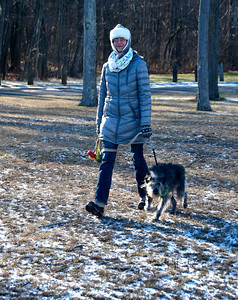 12/15/2016 Mike Orazzi | Staff Emma Veseskis walks with her dog Goose in Stanley Quarter Park in New Britain afternoon.