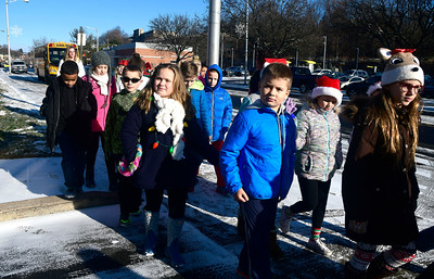 12/15/2016 Mike Orazzi | Staff South Side School's Community Club students while delivering coffee and doughnuts to staff at the police and fire departments, and the post office in Bristol Thursday morning.