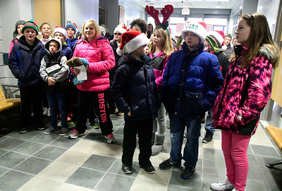 12/15/2016 Mike Orazzi   Staff South Side School's Community Club students while delivering coffee and doughnuts to staff at the police and fire departments, and the post office in Bristol Thursday morning.