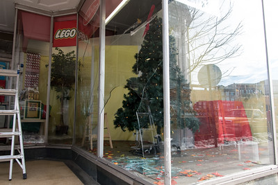 121916  Wesley Bunnell | Staff  The storefront window of Amato's Toy Store in New Britain was shattered in a robbery over the weekend.  A crew from Middletown Plate Glass was on hand to repair the damage on Monday afternoon.