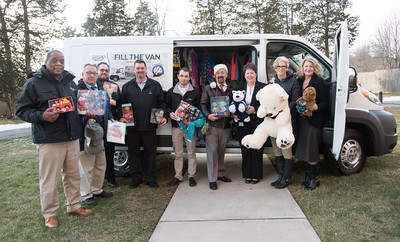 121916  Wesley Bunnell | Staff  Papa's Chrysler Dodge Jeep delivered a stuffed van full of toys and other necessities to the Prudence Crandall Center on Monday afternoon.  From left Dave Corbin from sales, Sales and Parts Director Bill Vetre, General Manager Sean Lawlor, Tom Shirley from parts, Service Advisor Jordan McMahon, Director of Marketing A.J. Maida, Executive Director of the Prudence Crandall Center Barbara Damon, Owner of Papa's Lisa Papa-Thiesfeldt and Director of Development for the Prudence Crandall Center Carolyn Jasper.