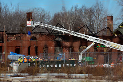 12/21/2016 Mike Orazzi | Staff Crews inspect the historic train station in Berlin after  an early morning fire Wednesday morning.
