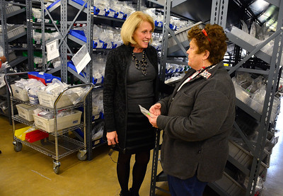 10/27/2015 Mike Orazzi | Staff Ultimate Companies President and CEO Nancy Brault talks with state rep Betty Boukus in the company's Forestville location.