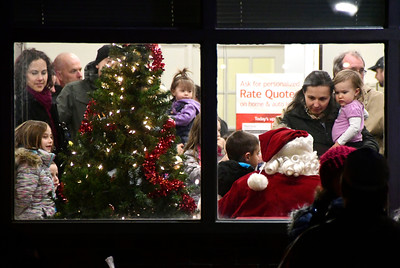 12/2/2016 Mike Orazzi | Staff Santa inside the Bank of America on the Southington Town Green during the Southington Hospitality Night held on the town greens in Plantsville and Southington Friday evening.