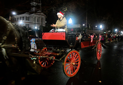 12/2/2016 Mike Orazzi | Staff Horse drawn carriage rides during the Southington Hospitality Night held on the town greens in Plantsville and Southington Friday evening.