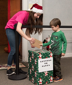 120216  Wesley Bunnell | Staff  Tina Sawyer helps Justin Whipple, age 4, with his letter to Santa at the Santa's Workshop on Friday evening at the Mortensen Community Center in Newington.