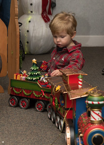 120216  Wesley Bunnell | Staff  Cullen O'Neil, age 20 months, plays with a toy train set during Santa's Workshop which was held on Friday evening at the Mortensen Community Center in Newington.